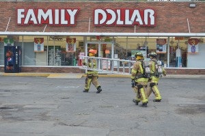 Turkey Creek Fire Territory Firefighters prepared to check the roof for a gas leak at Family Dollar, Syracuse