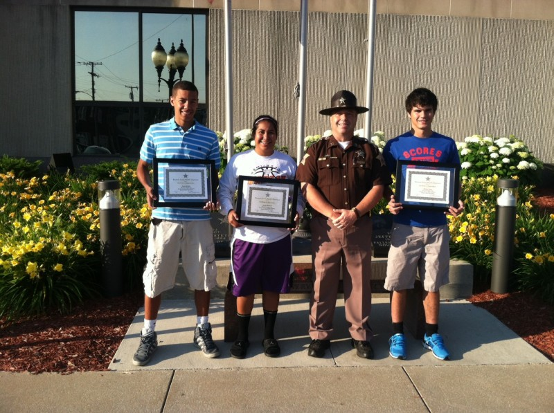 Pictured with Kosciusko County Sheriff's Department Captain Aaron Rovenstine are this year's winners of the Phillip Hochstetler Memorial Scholarships. From left are Zarek Finley, Gabby Monroy and Jordan Acton. (Photo by KCSD Sgt. Chad Hill)