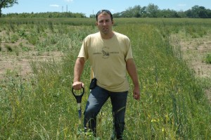 Jamie Scott stands in a section of cover crops on his farm near Pierceton. He extensively uses the practice of planting cover crops to protect the soil and hopes to see more farmers do the same.  (Photo by Tim Ashley)
