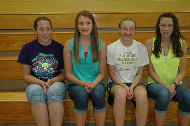 Wawasee Middle School eighth-graders who maintained straight A's on all report cards during their three years of middle school. From left are Riley Kunkle, Madison McBride, Bridgette Yoder and Paige Miller. (Photo by Tim Ashley)