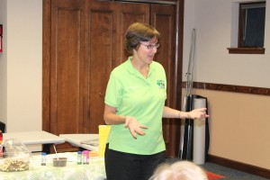 Shelly Heckert, a presenter from KC Recycling Depot, came to the Syracuse Library on Wednesday, June 19. She talked to teens about the role of pollution on the aquifer. Heckert instructed the young people in building a model aquifer made with chocolate chips, ice cream and soda. One of the participants said they had no idea that having clean drinking water was so complicated. She gave two bird houses as prizes for the winners of the environmental Bingo game. (Photo provided)