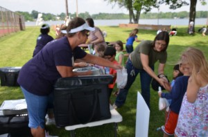 Parents line up with their children at Bixler Park on Center Lake in Warsaw to receive a free, nutritional packed lunch provided by Warsaw Community Schools.  (photo by Alyssa Richardson)