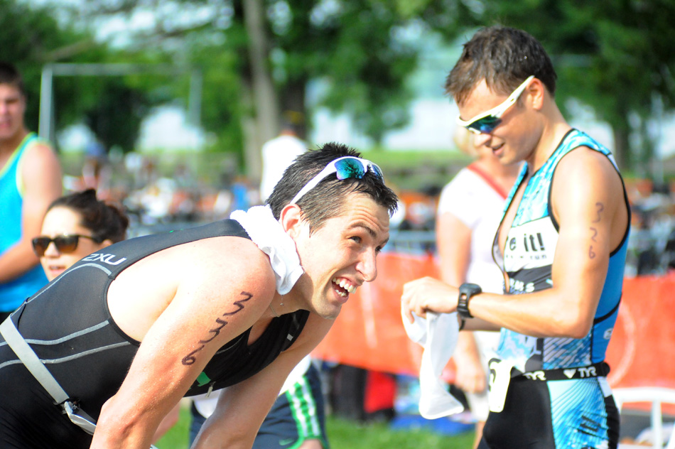 Warsaw Optimist Triathlon champion Anthony Klingler, left, takes a breather as third-place finisher Bryan Conger checks his time.