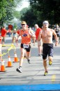 Andrew Saal, left, chases John White to the finish line.