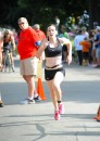 Cate Kelley was the first physical female to cross the finish line.