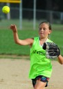 Kylie Fisher throws to first to record an out for the Lil' Warriors.