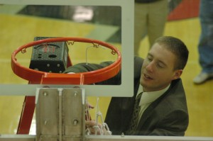 Phil Mishler, shown cutting down the sectional nets in 2005, has resigned as head coach of Wawasee's boys basketball program.