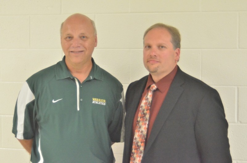 Wawasee athletic director Steve Wiktorowski (at left above) was named the new boys basketball coach for the Warriors Tuesday night. At right is Wawasee High School principal Mike Schmidt (Photo by Nick Goralczyk)