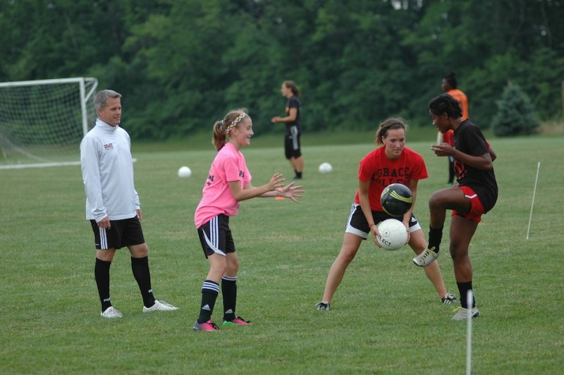 Soccer players take part in a clinic at Grace College. The free clinics for girls ages ......, are held each Monday night at Miller Field (Photo provided by Grace College Sports Information Department)