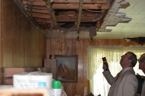 Warsaw Code Enforcement Officer Larry Clifford, left, and Warsaw Building Commissioner Todd Slabaugh inspect the interior of a house at 1405 Ranch Rd., Warsaw, that will be demolished unless the owners come up with funding for repairs in the next 30 days. (Photo by Stacey Page)
