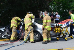 Richard Anderson, 77, of Winona Lake, was extricated from his vehicle following a Friday afternoon crash in Warsaw. (Photo by Stacey Page)