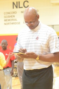 Former Ohio State and Pacers star Clark Kellogg signs an autograph for a fan Friday.