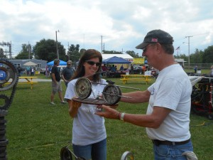 Michelle Fisher presents a trophy to John Drummond. Drummond won the Best Vintage class in the bike portion of the show. Drummond purchased his motorcycle in 1968, but before Saturday, he had never won an award for his bike. However, in a turn of events, Drummond won at the Dixie Days Car and Bike Show after he had finalized the bike's sale that very morning. Drummond was very grateful to the judges and their decision. (Photo by Stephanie Loney)