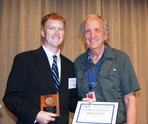 Robert Hecky, right, editor-in-chief of the Journal of Great Lakes Research, presents the Chandler-Misener award to Dr. Nate Bosch, associate professor of environmental science and director of the Kosciusko Lakes and Streams research center at Grace College. (Photo provided)