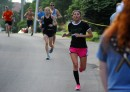 Corinne Cominator leads a group to the finish line of the 3.3-mile race.