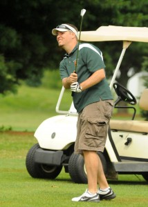 Nate O'Connell attempts a chip shot during play at the 2013 Wawasee Warrior Open. (Photo by Mike Deak)