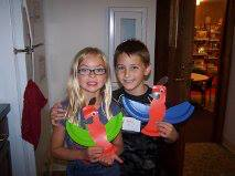 Sydnee Keith and Devin Van Lue show off their creative dinosaurs they made at Dino Day Food and Fun at the Milford Public Library. They had dinosaur bones (scooby snacks), dinosaur toenails (Bugles) and swamp water (green punch) for a snack. (Photo provided)