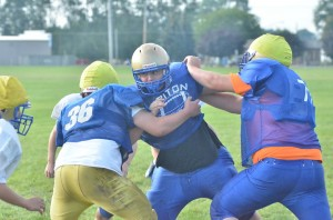 Junior Justin Heffner (middle) will help to anchor the line on both sides of the ball for the Trojans.