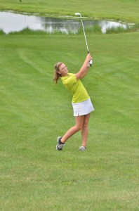 Wawasee's Elizabeth Jackson goes for the green on number four at South Shore. Jackson finished with a 48 on the night.