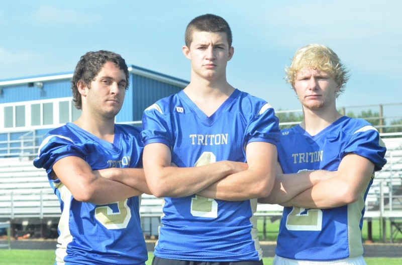 Pictured from left to right are Trojan senior captains Josey Farmwald, Jayden Mosier and Cole Creighbaum.
