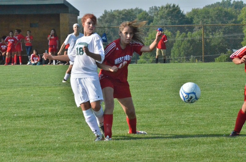 Wawasee's Natalie Jones gets physical with West Noble's Jocelyn Rivera. Rivera scored twice for the Chargers Wednesday night.