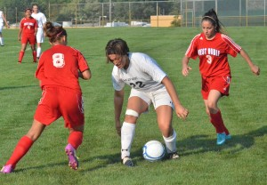 Wawasee's Caitlin Clevenger keeps control between West Noble's Olga Landeros (8) and Selene Murillo (3).