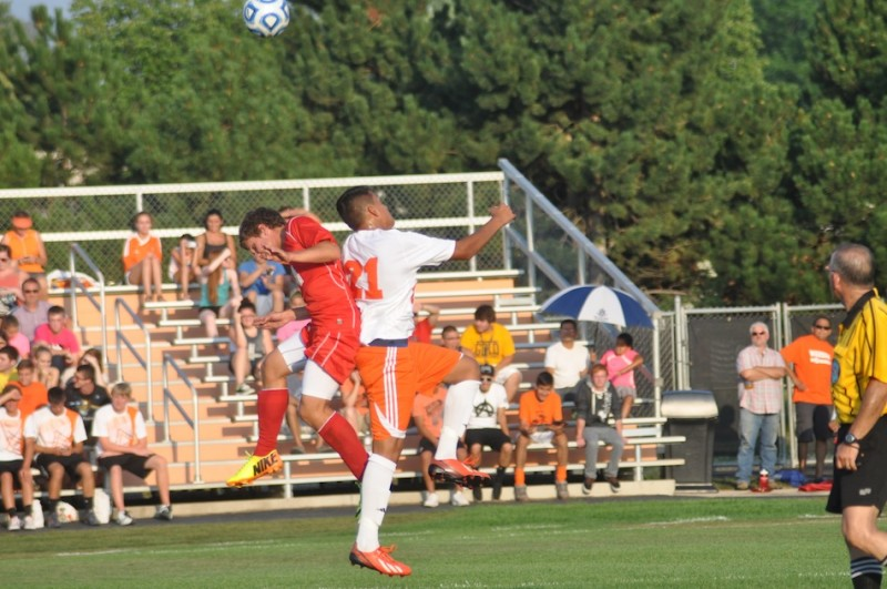 Junior Manuel Rodriguez heads the ball for the Tigers Thursday.