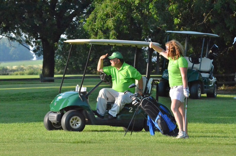 Wawasee head coach checks out a shot from Madison Beaman on the ninth fairway.