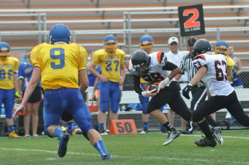 Tyler Packard heads upfield for Warsaw in junior varsity football action Saturday. Packard scored on a fumble return as the Tigers topped East Noble 17-0 (Photos by Amanda Farrell)