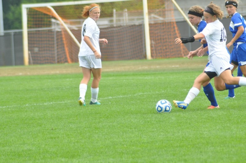 Warsaw's Elizabeth VanWormer battles for the ball versus Marian Saturday. The Tigers tied the defending state champions 2-2 (Photos by Amanda Farrell)