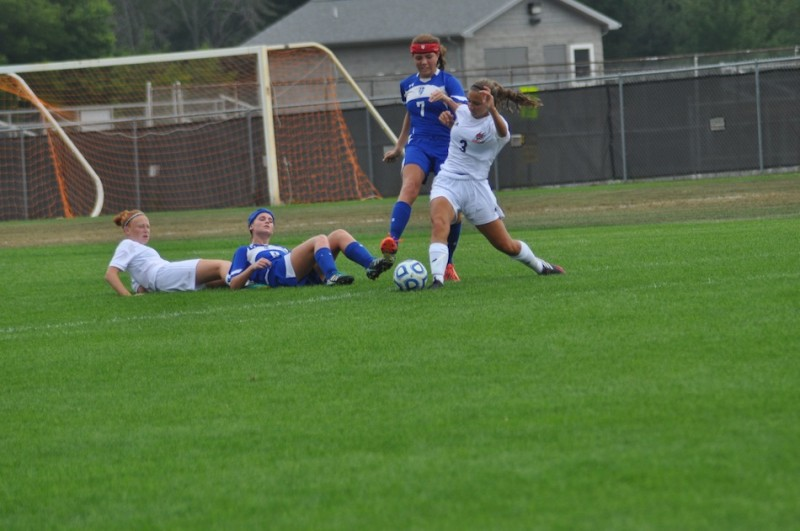 Julie Frazzetta of Warsaw tries to control the ball Saturday.