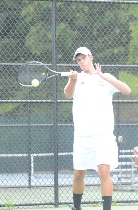 Warsaw senior standout Kyle Wettschurack smashes a forehand at Mishawaka Marian Monday. The Tigers won 4-1 to improve to 3-0 (Photos by Scott Davidson)