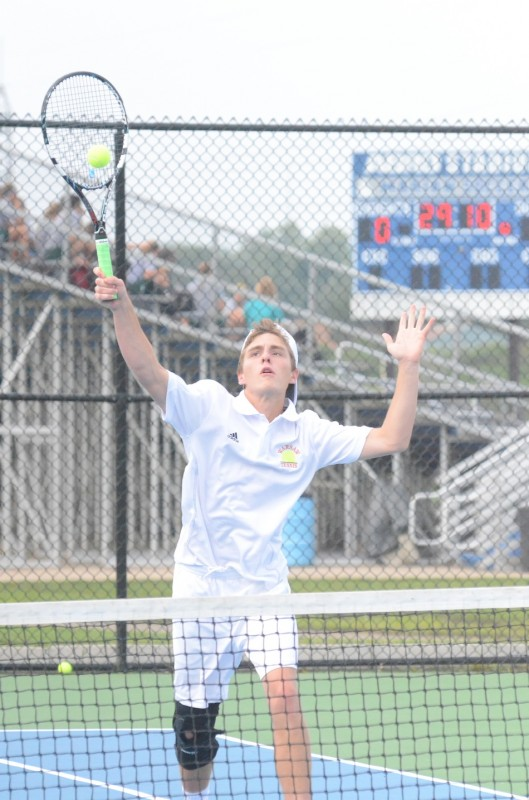 Senior Evan Miller reaches for an overhead Monday at Marian. Miller paired with Nic Jansen to win at No. 1 doubles for the undefeated Tigers.