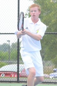 Caleb Ray follows his backhand return at No. 3 singles Monday for Warsaw. Ray won 6-2, 6-2 as the Tigers topped Marian 4-1.