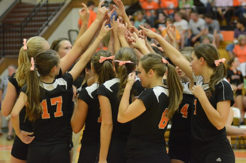 The Warsaw volleyball team gathers together just before facing Elkhart Memorial Thursday night.