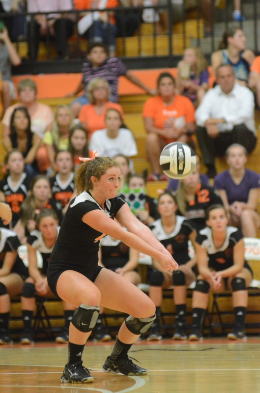 Warsaw's Emily Poe passes the ball versus Elkhart Memorial Thursday night. Memorial topped the host Tigers 3-1 for a key NLC victory (Photos by Scott Davidson)