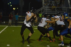 Warsaw quarterback Austin Head looks for a receiver against East Noble.
