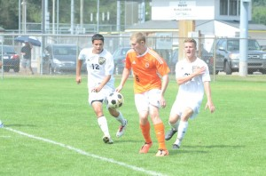 Sam Allbritten works to control the ball versus a pair of Penn defenders. Allbritten had a goal in the 2-2 tie Saturday.