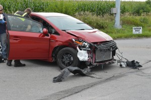 The driver of this vehicle was being treated at the scene, of a two vehicle accident, for a possible broken finger.
