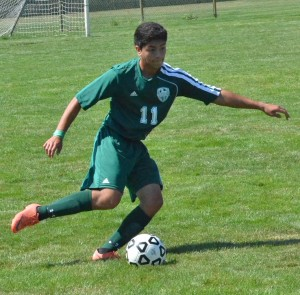 Wawasee's Javier Lopez looks to pass Saturday morning against Concord.