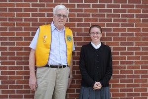 Richard Tuttle of the Warsaw Evening Lions Club congratulates Megan Rangel on receiving the Warsaw Evening Lions Club Scholarship. (Photo provided)