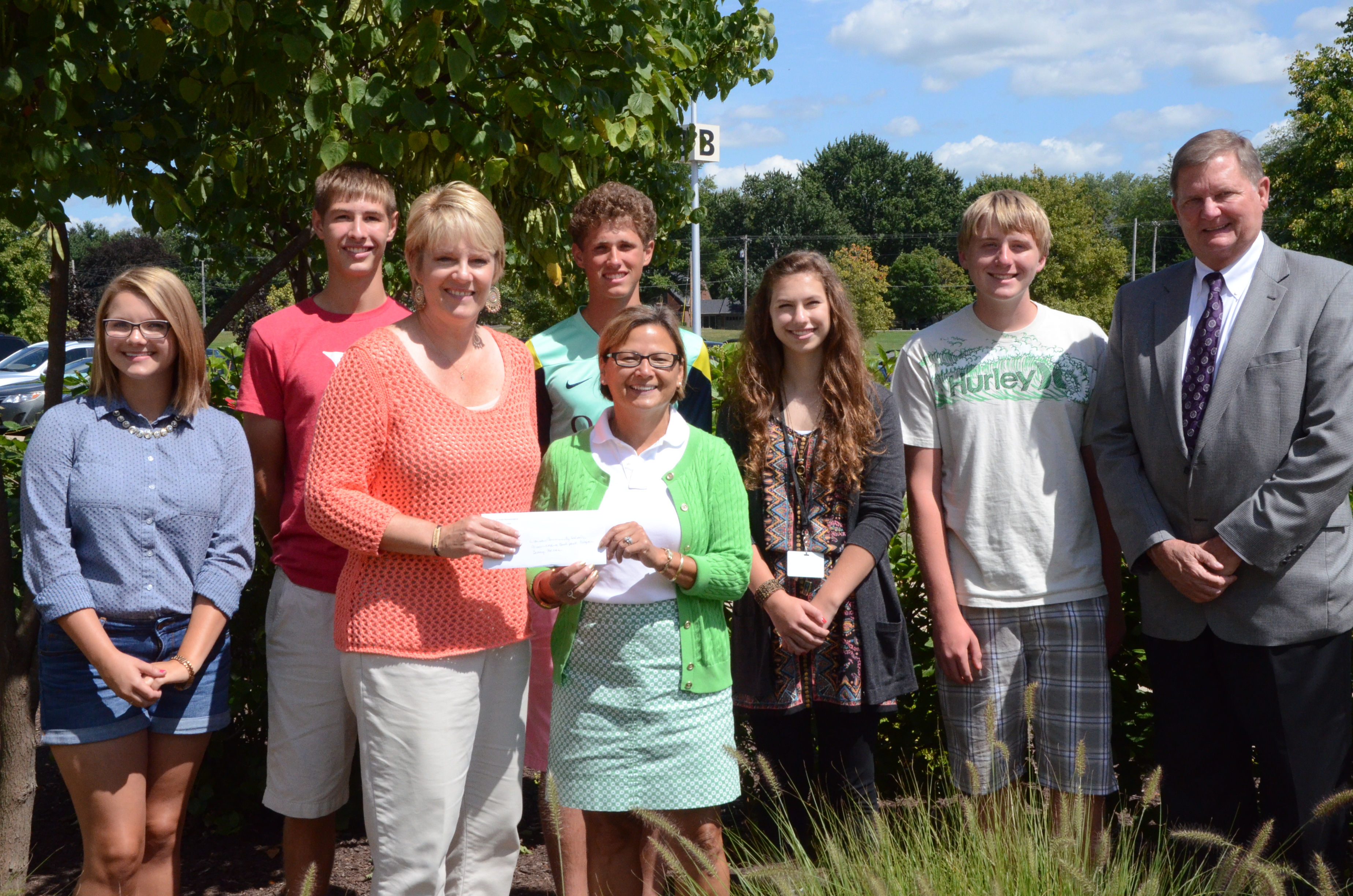 State Representative Rebecca Kubacki presents a check for $5,000 to Tracey Akers, Superintendent Dr. Craig Hintz and student organizers of the Boomerang Backpack Program.  (Photo by Alyssa Richardson)