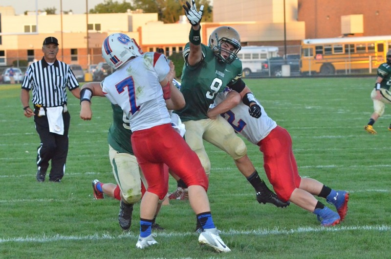 Wawasee's Braxton O'Haver nearly bats down a pass from Whitko's Ethan Nicodemus.