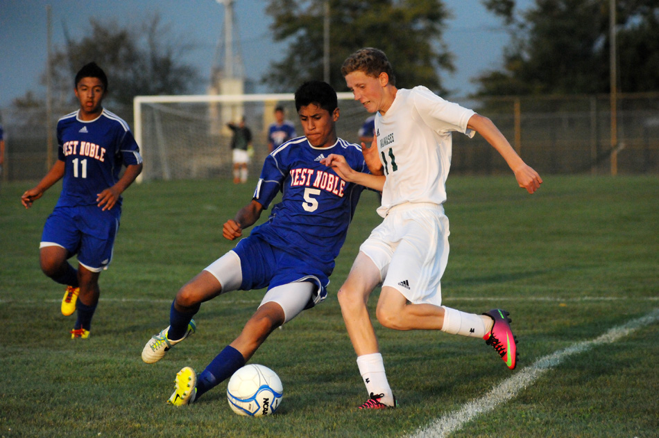 West Noble's Alejandro Flores and Wawasee's Carter Jones square off for a loose ball during West Noble's 6-0 victory Thursday night in Syracuse. (Photos by Mike Deak)