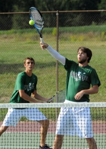 Jake Hutchinson of Wawasee volleys home a shot while doubles mate Doug Hapner covers.