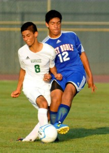 Wawasee's Luis Camargo tangles with West Noble's Daniel Silva.