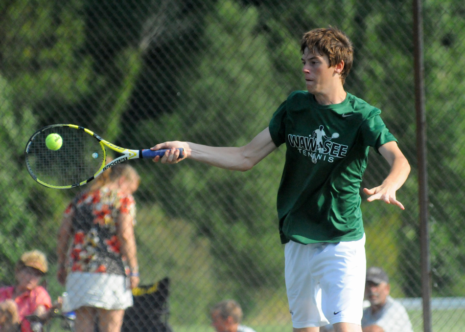 Wawasee's Chase Myers rips away against Central Noble Tuesday afternoon. Myers and one doubles partner Dylan Houser won in straight sets. (Photos by Mike Deak)