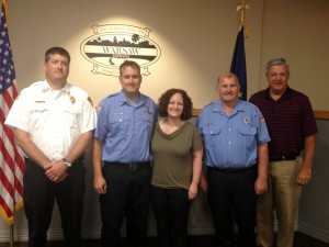 Jason Neher, second from left, was sworn in today as the newest member of the Warsaw-Wayne Township Fire Territory. He is shown with, from left, WWFT Chief Mike Brubaker; his wife, Mandy Neher; his father, Larry Neher; and Warsaw Mayor Joe Thallemer. (Photo by Stacey Page)