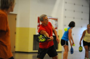 Roy Wentz returns volley during his game of pickleball.