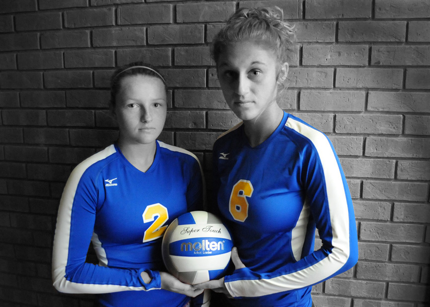 Triton volleyball returners Krystal Sellers, left, and Emily Koontz hope to add some color to an exciting club this fall. (Photo by Mike Deak)